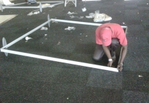 Setting up the frame for a portable fabric wall
